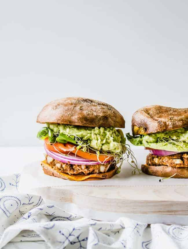 vegan bbq guacamole burger on sweet potato bun