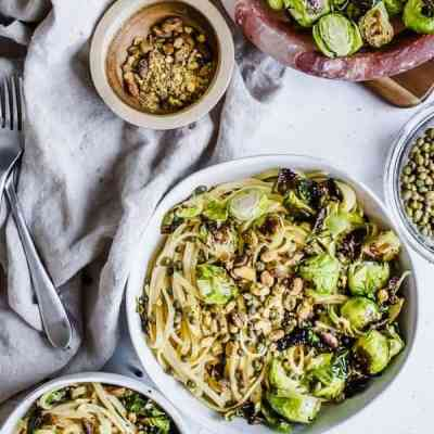 Cheesy Tahini Pasta with Brussels Sprouts, Capers, and Pistachios