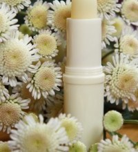 Lip Balm Surrounded by Flowers