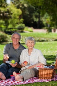 Couple with Picnic in Park