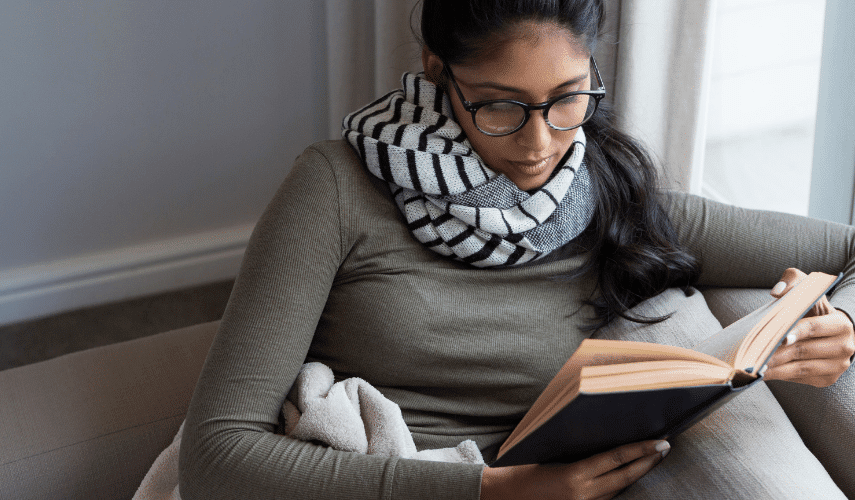 woman is reading a book of kratom definitions so she can use kratom safely