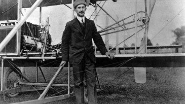 Orville Wright stood next to the first aeroplane to ever be flown.