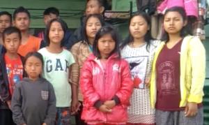Children in India receive a guitar