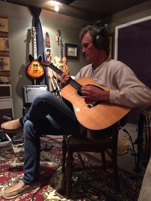 Chris Lah playing guitar for The Script
