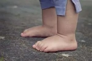 Picture of a toddler's feet from the knees down.