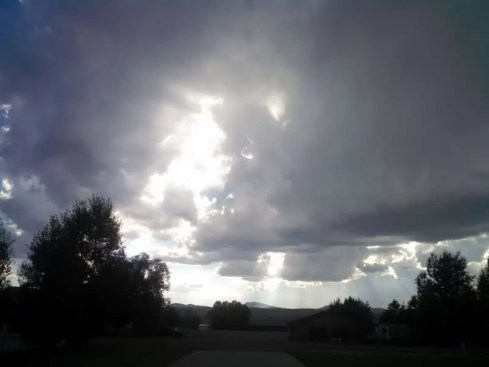 Sunlight breaking through the clouds of a storm.