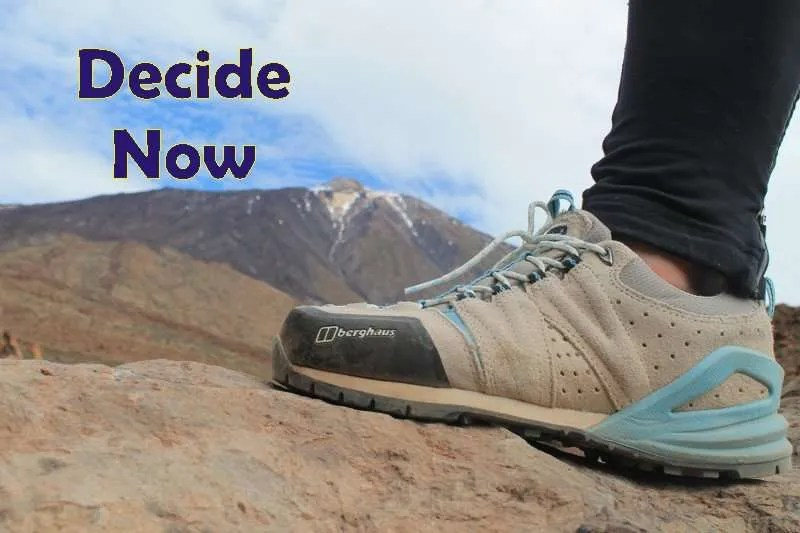 A foot in a hiking shoe planted on a rock with the title Decide Now.