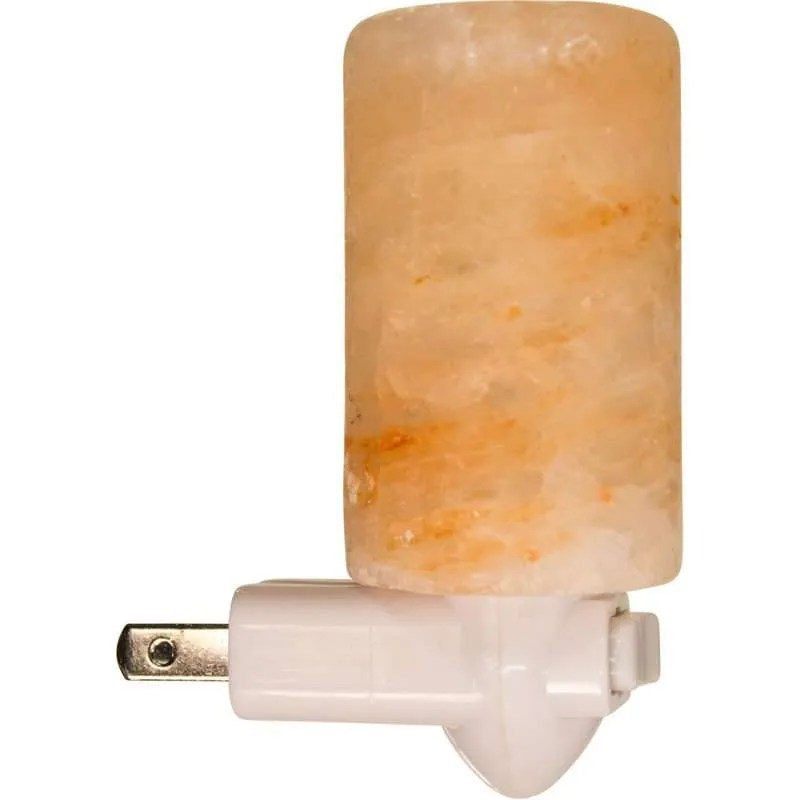 Night lamp with polished cylinder of Himalayan salt.