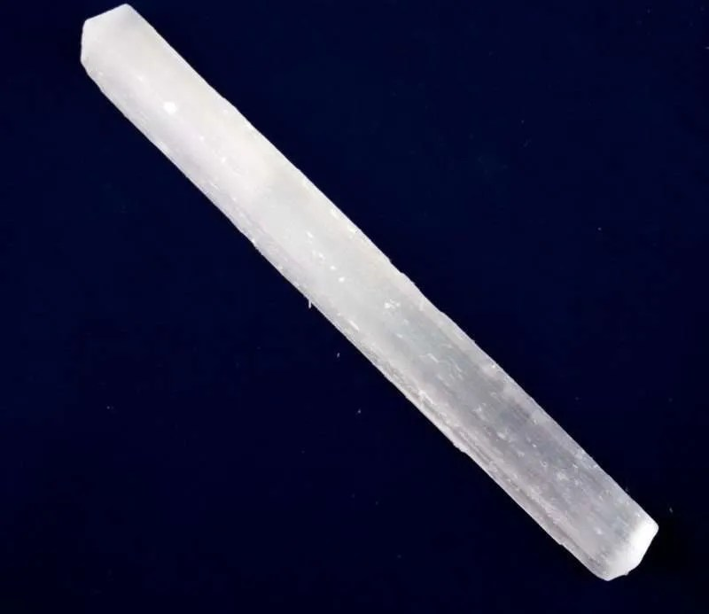 Seven inch rough selenite stick.