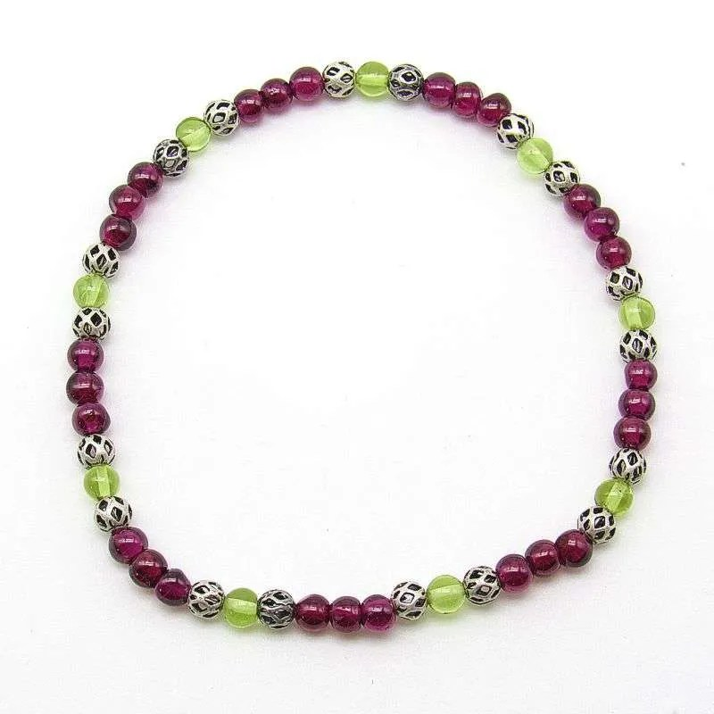 Garnet and peridot 4mm bead bracelet.