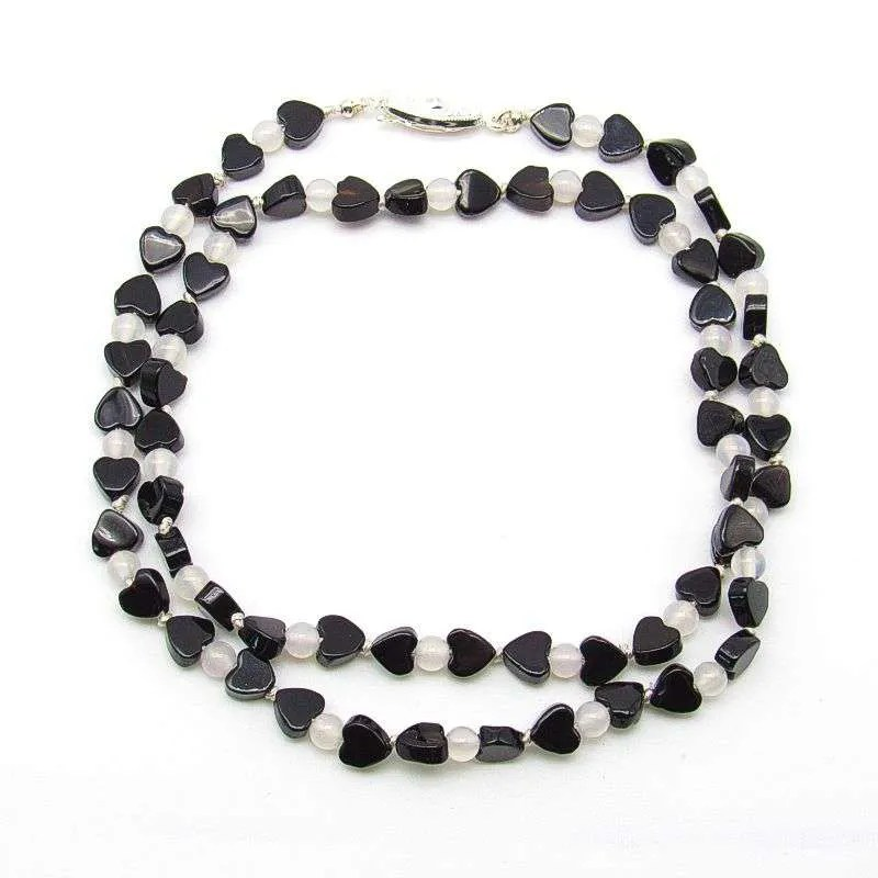 "20"" black onyx heart and round snow quartz bead necklace."