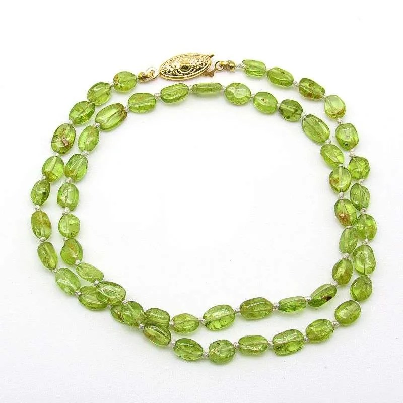 "18"" peridot flat oval bead necklace."
