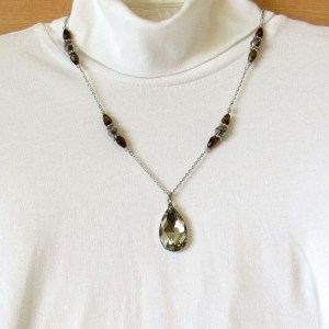 Tiger's eye decorated chain with a faceted crystal teardrop pendant