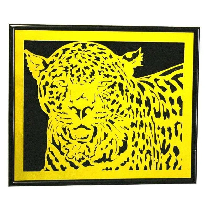 Yellow mirrored plastic leopard wall hanging.