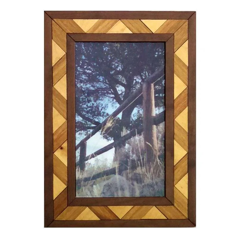 Photograph of rustic pole fence in handcrafted hardwood frame.