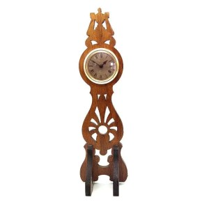 Mini fretwork hardwood clock.