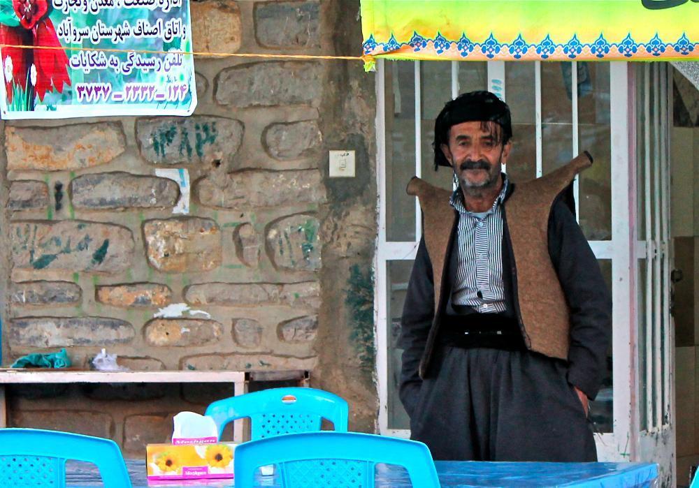 shopkeeper Ouraman Takht, Iran