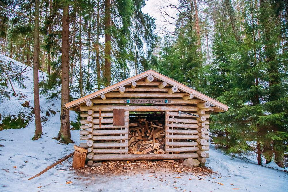winter firewood hut nuuksio national park finland