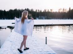 Kuusijärvi lake sauna experience Finland jumping in ice