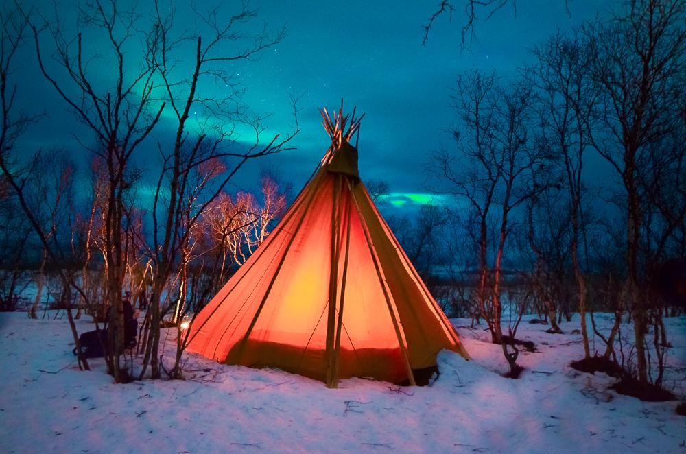 abisko northern lights photo tepee lights over lapland sweden