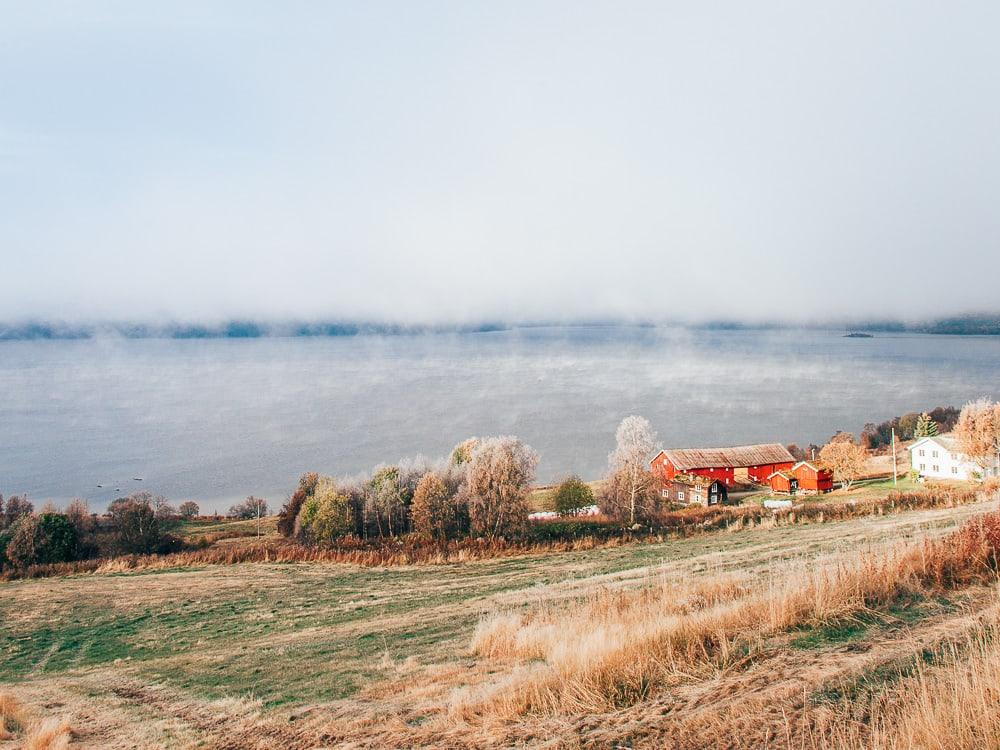 autumn in norway, rauland telemark fog and frost on the lake