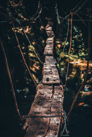 an old dangerous bridge marks the call to adventure - on a life coaching journey you've already received the call to change your life, will you take the next steps outside of your comfort zone?