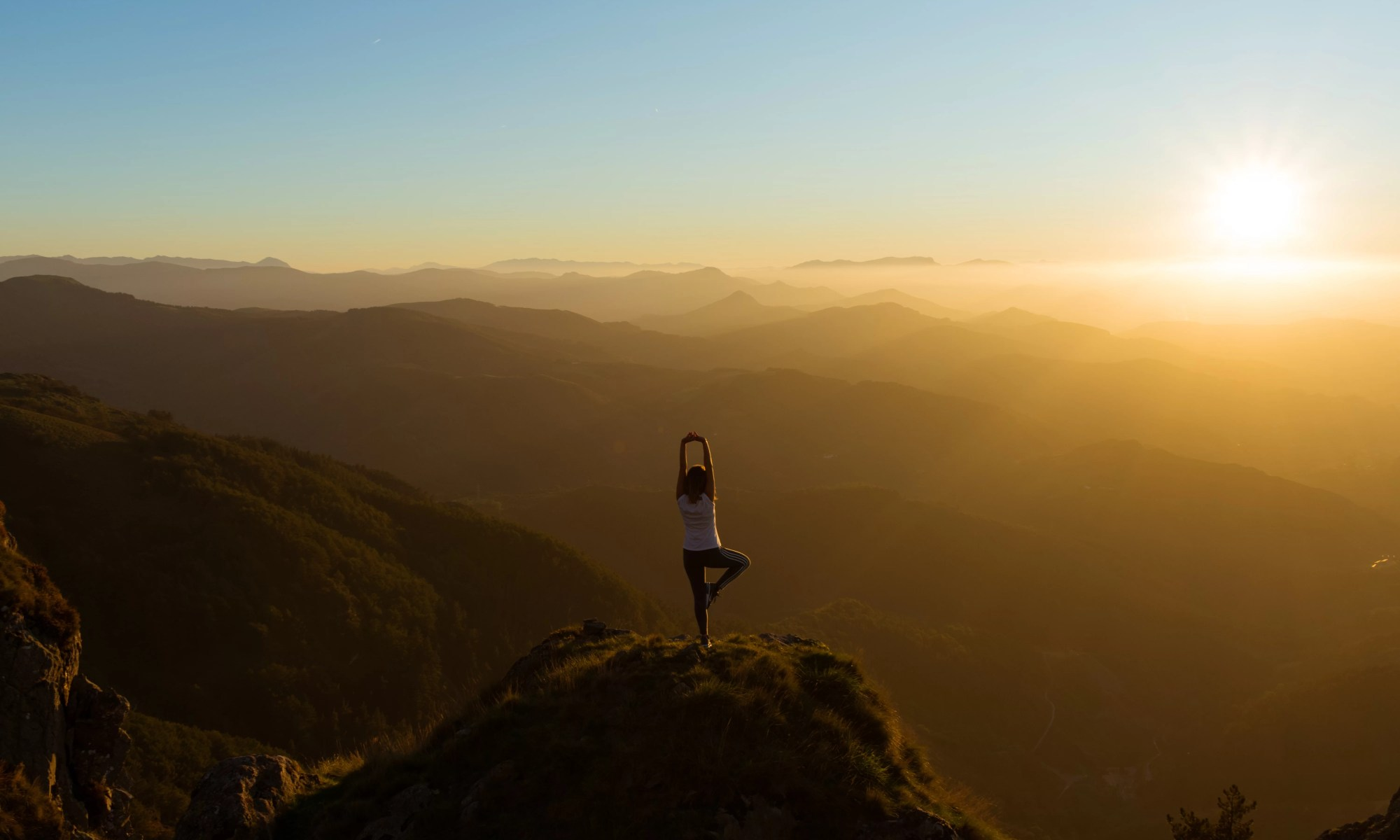 Tree Pose on a Mountain at Sunrise