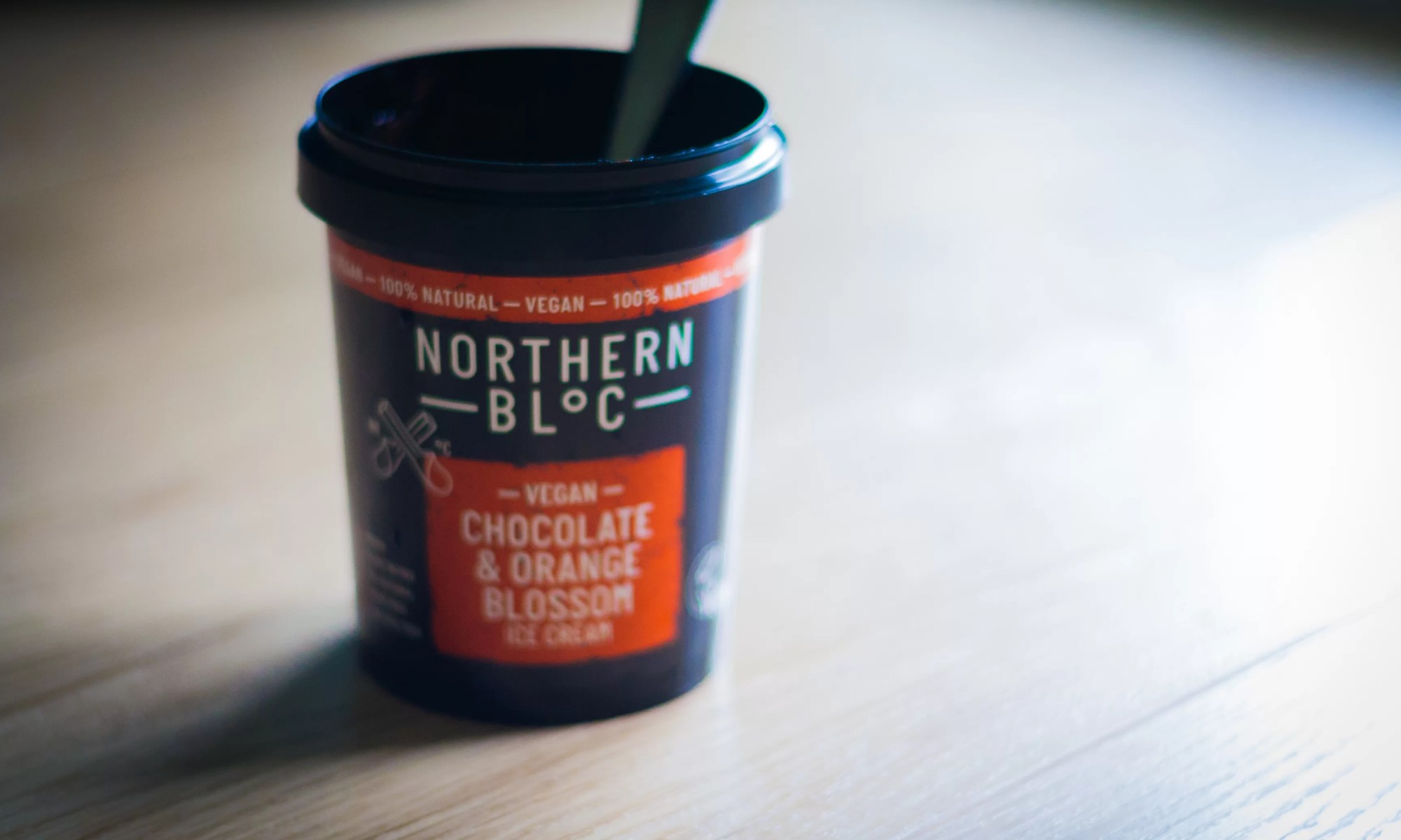 An empty tub of Northern Bloc Vegan Ice Cream