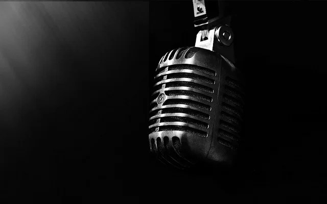 black and white image of vintage condenser microphone for voice