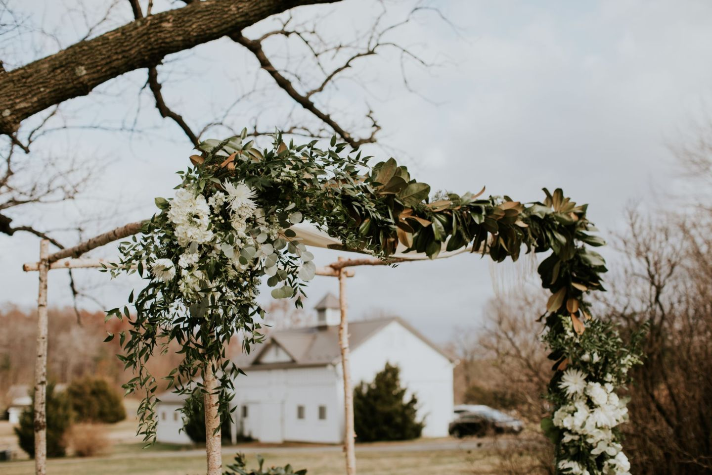 winter wedding flowers - winter chuppah - chuppah with magnolia
