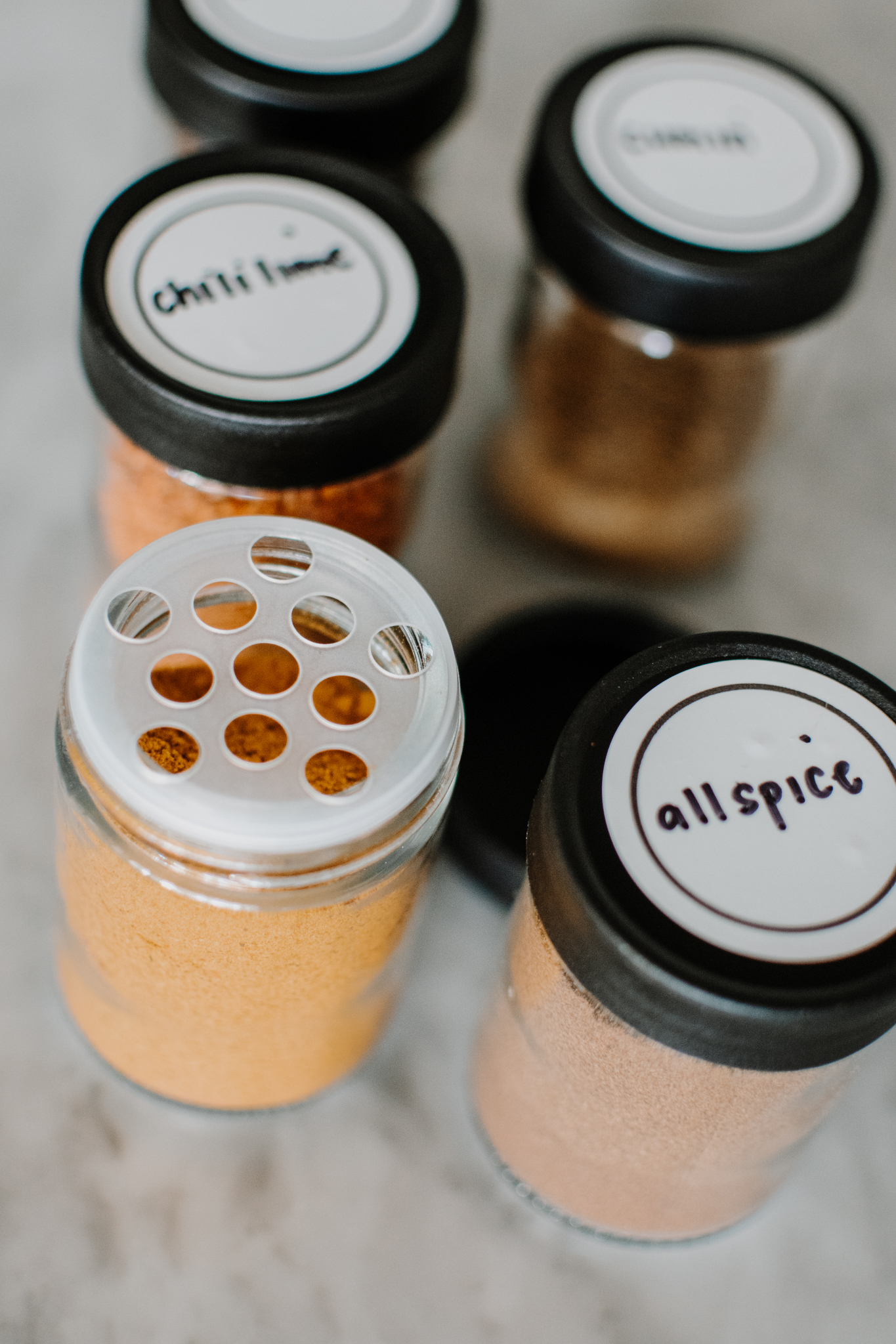 spice drawer organization - decanting spices into glass jars