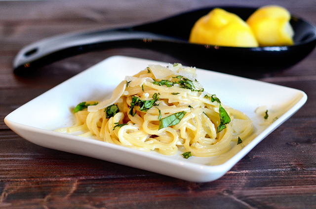 Creamy Lemon Parmesan Pasta || HeathersDish.com With 5 ingredients you too can turn weeknight dinners into something special. Tart lemons, salty parmesan, earthy basil and perfectly cooked pasta all come together to create a magical dish that pairs well with any protein or vegetable! #healthy eating #simpledinner