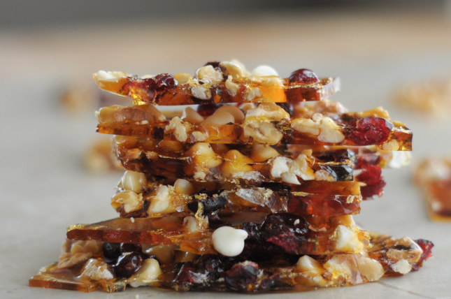 Cranberry, white chocolate and walnut brittle is a super simple and beautiful dessert option for this holiday season. Serve as-is, or crumbled on top of ice cream for a winning dessert.