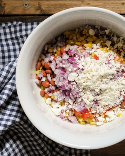 Summery Corn, Pinto Bean and Feta Salad is the perfect summer side. This beauty doubles up nicely and keeps in the fridge for days! @heathersdish