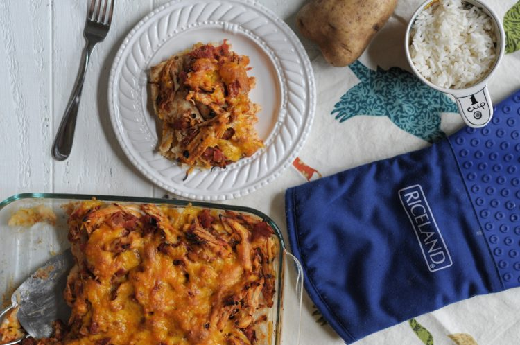 Cheesy Rice and Potato Enchiladas with Shredded Chicken Ragu make a fun and funky dinner that you'll never forget! With @RicelandFoods @heathersdish