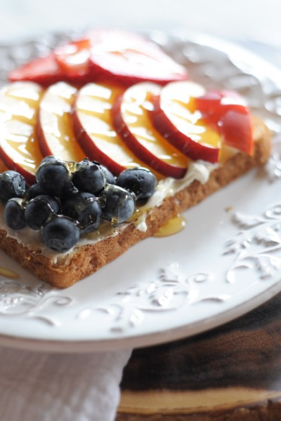 Rainbow Fruit and Honey Toast makes breakfast exciting again! Perfectly ripe fruit, a bit of cream cheese, and a drizzle of honey turn this meal into a treat. @heathersdish
