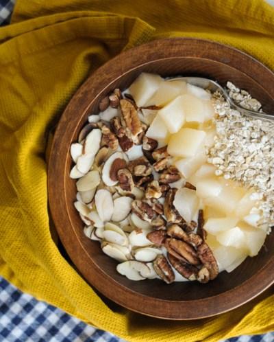 Cinnamon Nut Pear Crumble Yogurt Bowl makes breakfast fun again! Homemade vanilla bean yogurt, soft-crunchy pears, oats, toasted nuts and sweet-spicy cinnamon are heaven together! @heathersdish