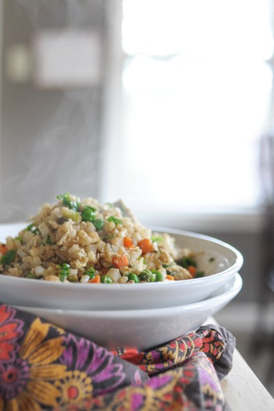 Cauliflower Fried Rice is all vegetable goodness and done in a flash! You'll never miss the rice in this incredible side dish! #sponsored #produceforkids @produceforkids @heathersdish