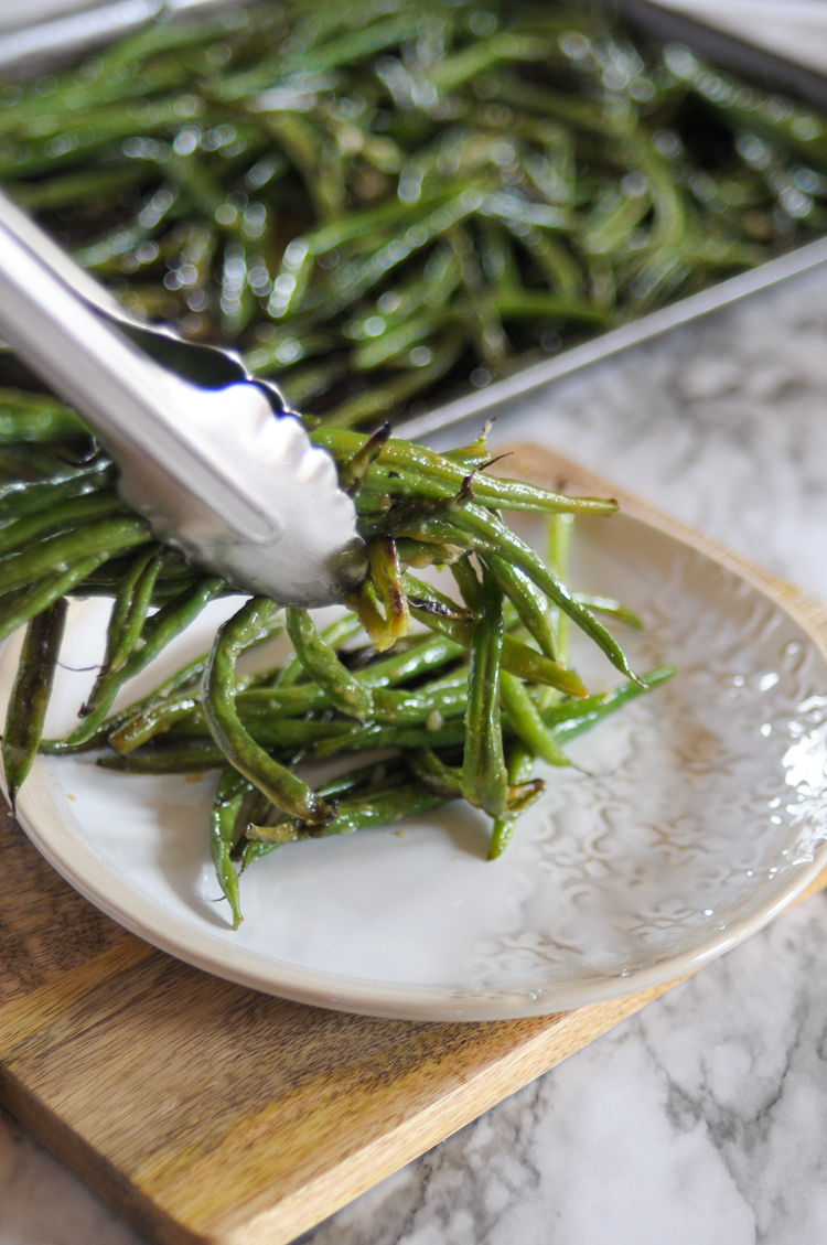 Roasted Green Beans with Fresh Garlic are a staple side dish for any meal. Enjoy alongside any protein you like, or add them to a veggie bowl or salad - they're good with anything!