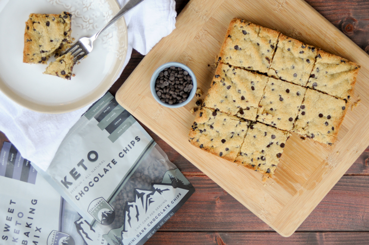 Sweet Keto Chocolate Chip Cookie Bars from Explorado Market are a delicious way to meet that sweet need without breaking your low carb day!
