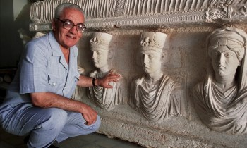 A 2002 picture of Khaled al-Asaad in front of a rare sarcophagus from Palmyra depicting two priests dating from the first century. Photograph: Marc Deville/Gamma-Rapho via Getty Images