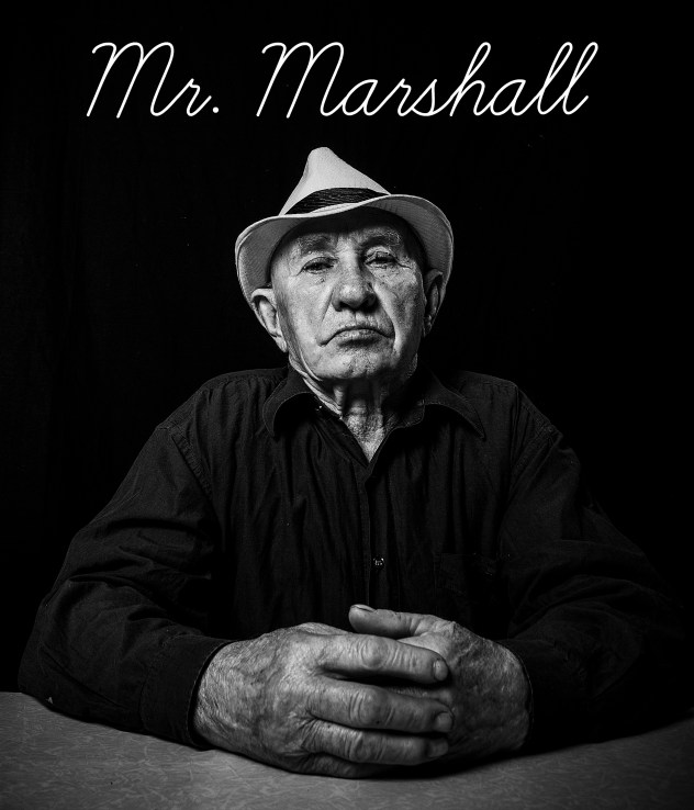Artistic portrait of an old man in a hat