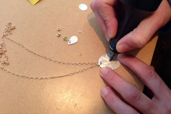 Heather engraving a new necklace.
