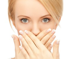picture of amazed woman with hand over mouth