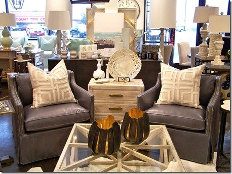 Pair of grey leather swivel chairs from heather scott