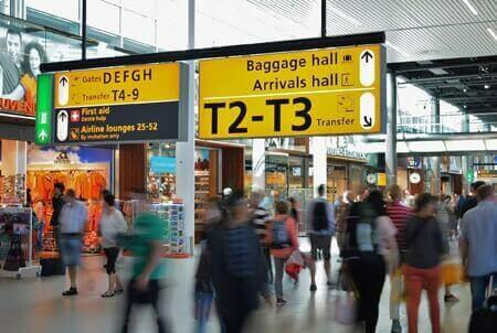 Passenger Transport Services - passengers at Heathrow airport terminal