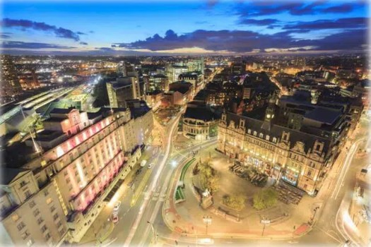 Leeds City Square and panoramic night view of skyline - Leeds, England