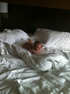 diaper free Jasmin enjoying the huge bed!