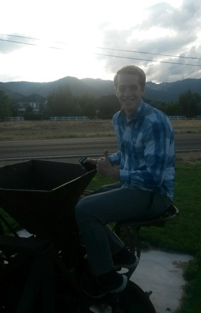 Kevin riding the tractor