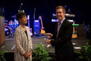 Lynn Stillman presenting Michael Moore with the Small Business of the Year Award